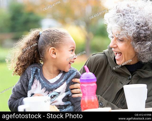 Playful grandmother and granddaughter
