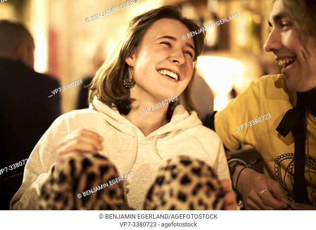 gregarious woman talking with man in restaurant
