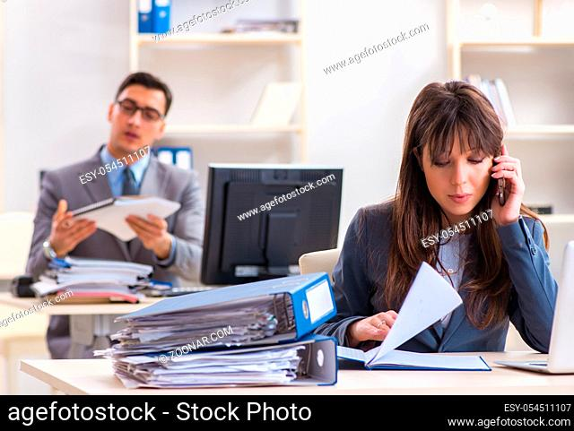 The man and woman working in the office