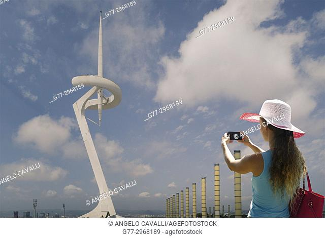 Tourist taking a photo of Montjuïc Communications Tower in the Olympic Park, Barcelona, Spain