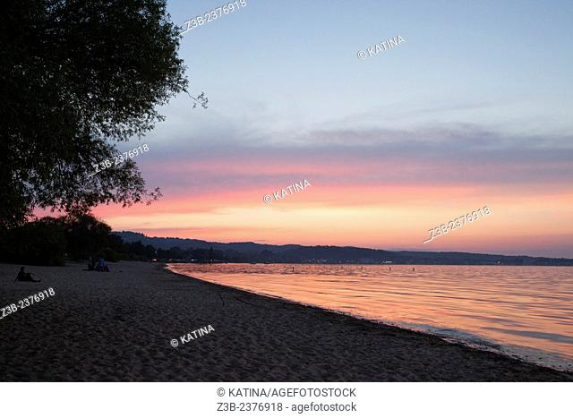 Brilliant pink sunset in summer on Lake Michigan in Traverse City, Michigan, MI, USA