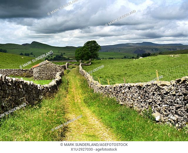 View down Goat Scar Lane above Stainforth to Smearsett Scar and Ingleborough Stainforth Ribblesdale Yorkshire Dales England