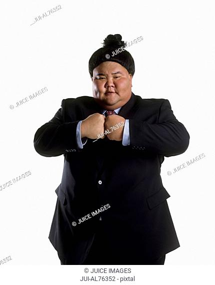 Portrait of a sumo wrestler in a business suit