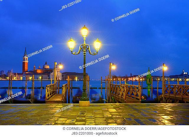 Illuminated Gondola station on Grand Canal and Church of San Giorgio Maggiore beyond , near Piazza San Marco, Venice, Veneto, Italy, Europe