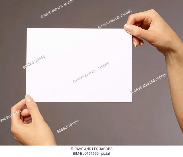 Caucasian woman holding blank card