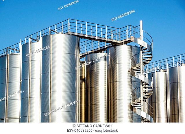 Silver wine Silos with blue sky in background