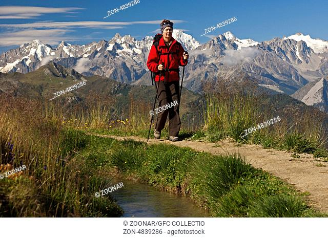 Hiker at the historic Verbier irrigation canal