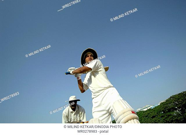 Indian right handed batsman in action playing hook shot in cricket match MR705L