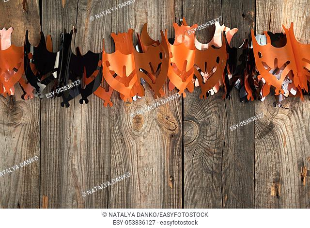 plastic garland on with bat figures, backdrop for Halloween