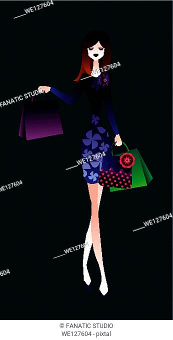 Woman carrying shopping bags and walking