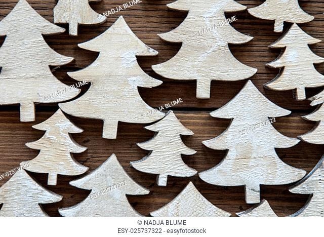 Macro Or Close Up Of Christmas Trees On Brown Wooden Background With Copy Space For Your Text Here Or Free Text. Vintage Style