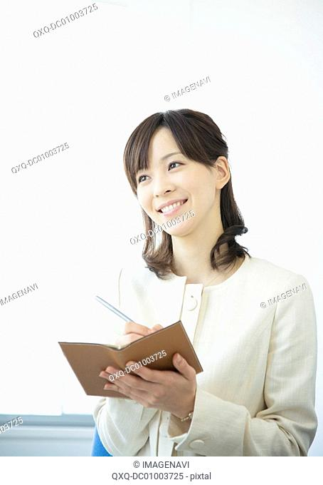 Businesswoman reporting