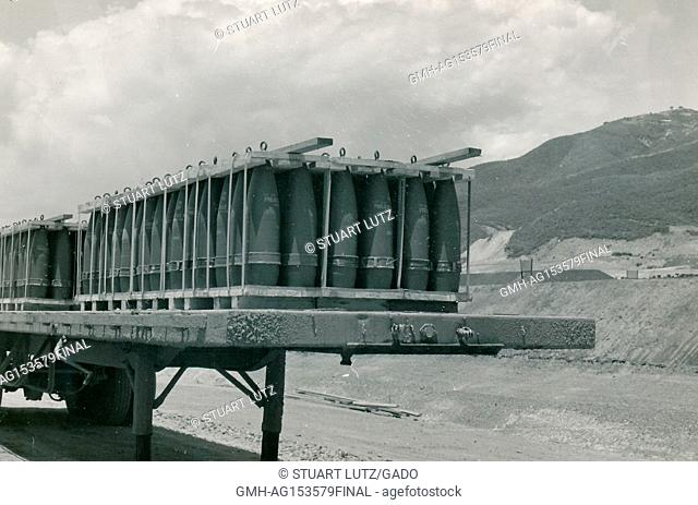 A large pallet of artillery shells is stacked on the back of a flatbed trailer during the Vietnam War, 1968