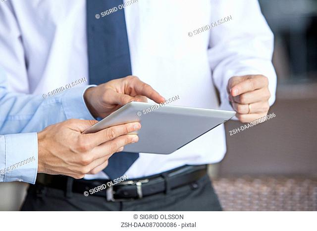 Businessmen using digital tablet