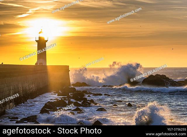 Scenic sunset over Atlantic Ocean. View with Felgueiras Lighthouse in Foz do Douro district of Porto city, second largest city in Portugal