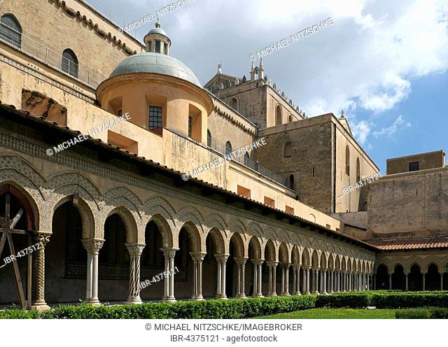 Cloister with ornate columns, courtyard of Monreale Cathedral, Monreale, Sicily, Italy