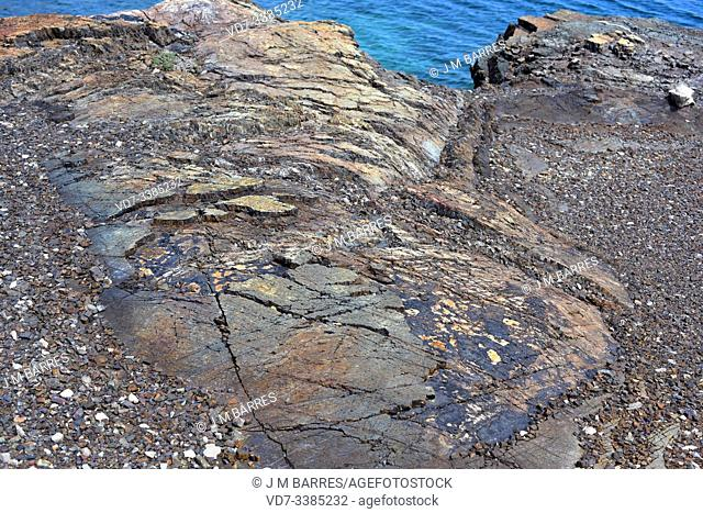 Fault plane is the fracture surface of fault. This photo was taken in Cala Mica, Menorca Island, Balearic Islands, Spain