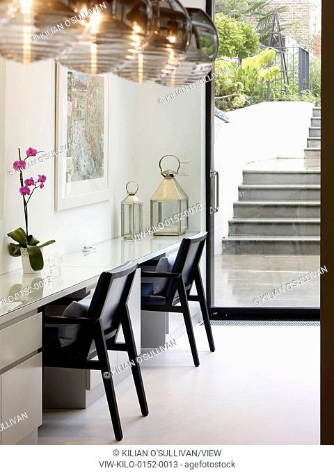 Living room work station. Maida Vale House, London, United Kingdom. Architect: Stiff + Trevillion Architects, 2014