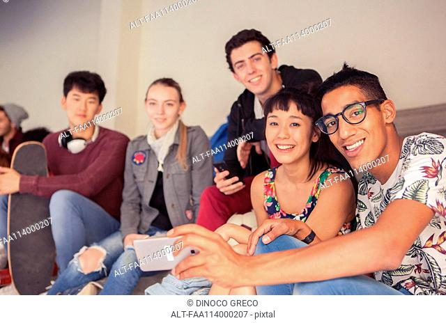 Group of friends hanging out together and posing for a selfie