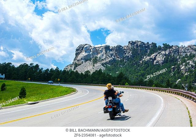 Mount Rushmore South Dakota Keystone traffic on road to National Memorial of Presidents in stone on mountain landmark attraction USA
