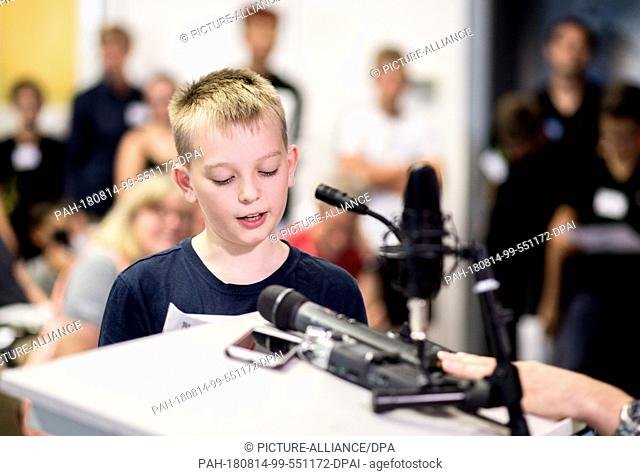 14 August 2018, Germany, Braunschweig: Pupil Tamino Gabriel (11) in conversation with German astronaut A. Gerst on the ISS during an event organised by the...