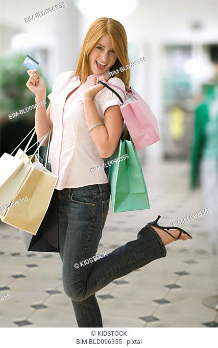 Caucasian teenage girl shopping with credit card