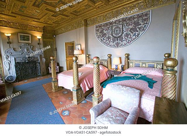 Interior of guest bedroom with displayed antique clothing of the day at Hearst Castle, America's Castle, San Simeon, Central California Coast
