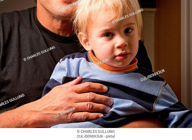 Father holding toddler son