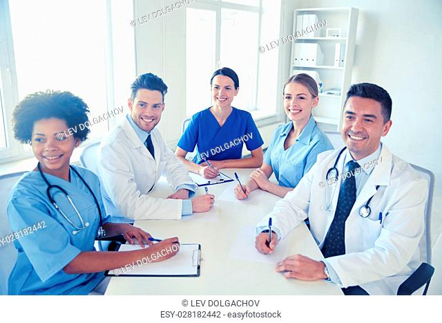 hospital, medical education, health care, people and medicine concept - group of happy doctors meeting at medical office