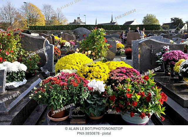 France, region of Brittany, cemetery of the village at All Saints' Day, tombstones with flowers