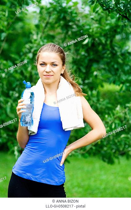 Smiling woman with water bottle after workout Debica, Poland