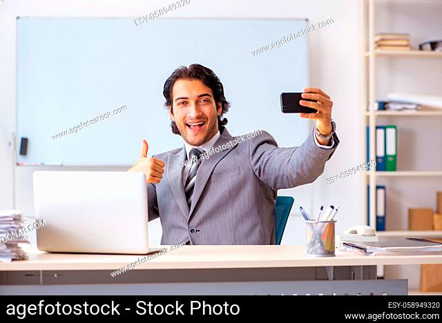 Young handsome businessman employee in the office