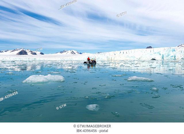 Zodiac boat with tourists navigating in front of Lilliehook glacier, Lilliehook fjord, Spitsbergen Island, Svalbard Archipelago, Norway