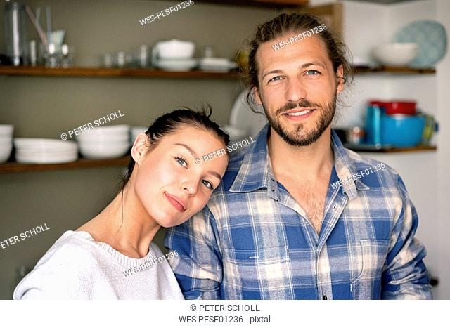 Portrait of a happy young couple at home