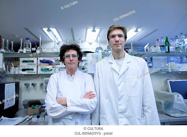 Portrait of male and female scientist in lab