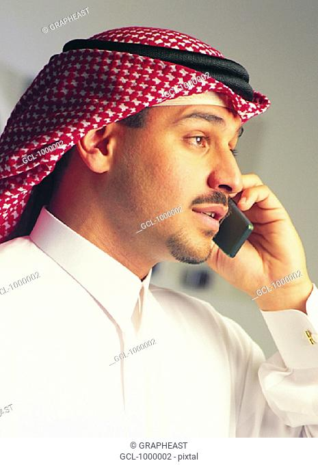 Arab man using cell phone