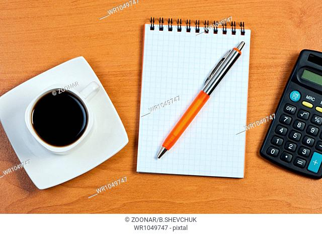 Coffee, notebook and pen on table