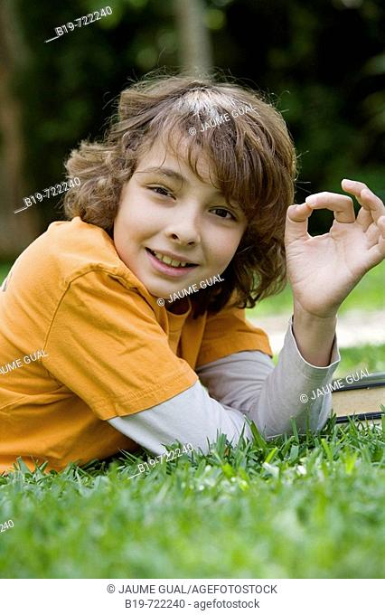 Boy laying on grass