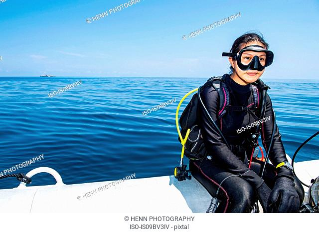 Woman in scuba gear on the way to a dive site, Komodo Island, East Nusa Tenggara, Indonesia