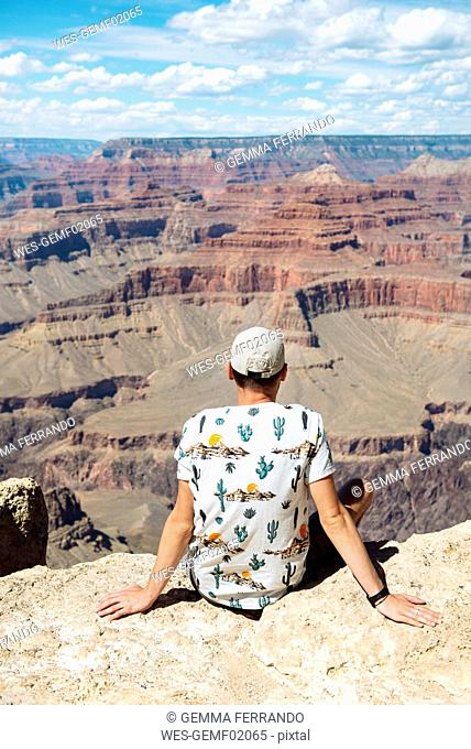 USA, Arizona, Young man enjoying the landscape of Grand Canyon National Park