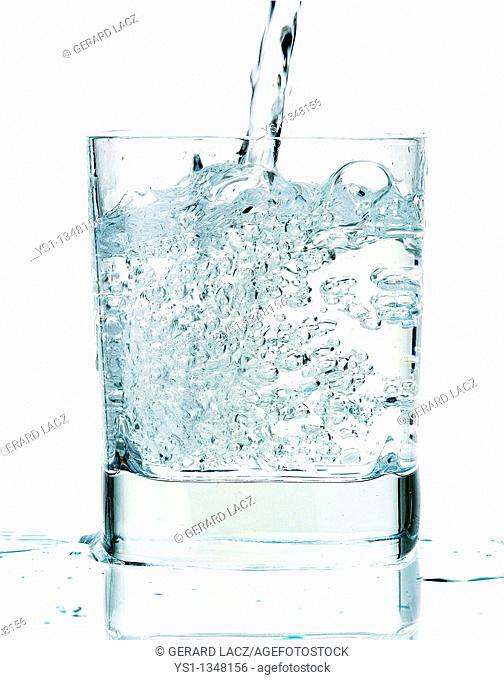 GLASS OF WATER AGAINST WHITE BACKGROUND