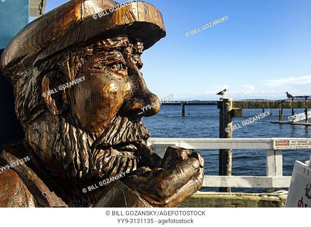 Wood carving of old Fisherman - Sidney, Vancouver Island, British Columbia, Canada