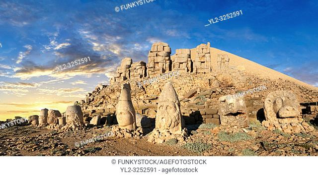 Statue heads at sunset, from right, Eagle, Herekles, Apollo, Zeus, Commagene, Antiochus, & Eagle, with headless seated statues in front of the stone pyramid 62...