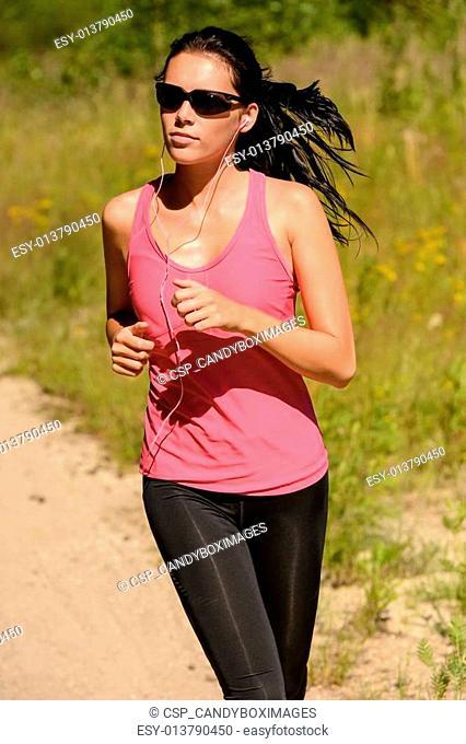 Athlete woman running training on sunny day