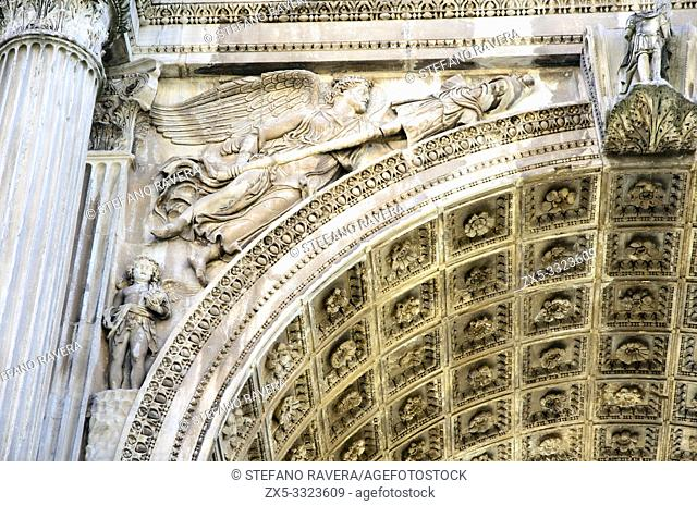 Detail of the Arch of Septimius Severus of a Winged Victory that carries the trophies - Roman forum - Rome, Italy