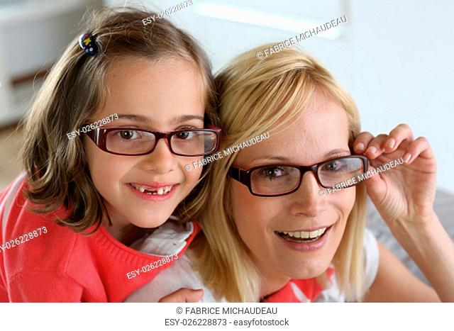Mother and daughter with eyeglasses on