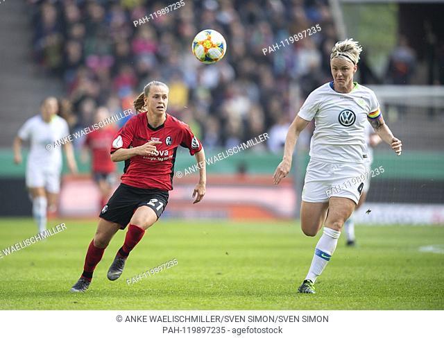 Klara BUEHL l. (FR) in duels versus Nilla FISCHER (WOB), Action, Wolfsburg (WOB) - SC Freiburg (FR) 1: 0, on 01.05.2019 in Koeln / Germany