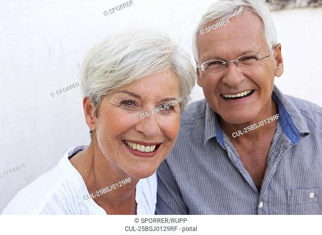 Senior couple smiling to camera