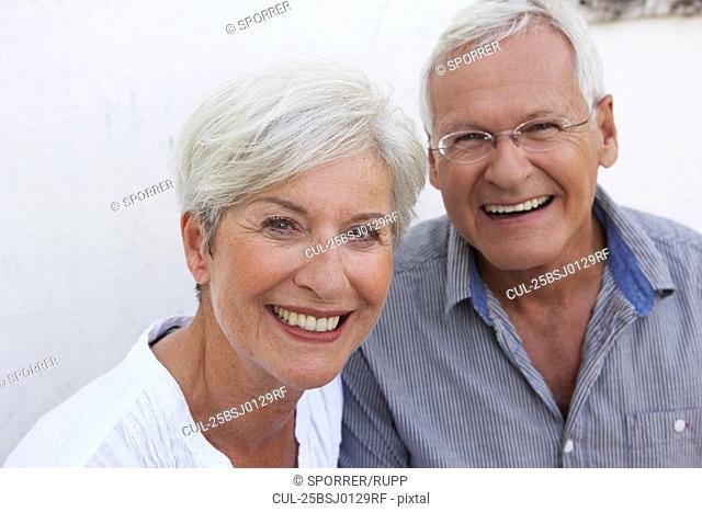 Senior couple smiling to camera