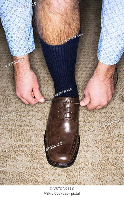 Man trying on dress shoes